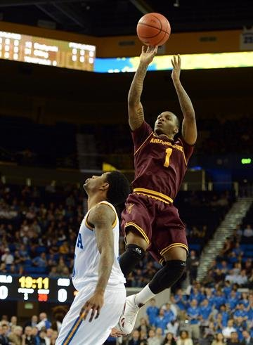 LOS ANGELES, CA - FEBRUARY 27:  Jahii Carson #1 of the Arizona State Sun Devils shoots a jumper over Larry Drew II #10 of the UCLA Bruins at Pauley Pavilion on February 27, 2013 in Los Angeles, California.  (Photo by Harry How/Getty Images) By Harry How