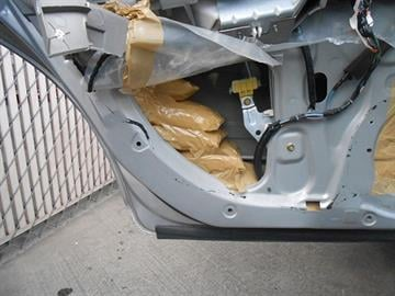 CBP officers at the Port of Nogales locate packages of meth concealed within the door panels. By Mike Gertzman