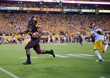 Cameron Marshall's 70-yard TD run highlighted ASU's win over USC in 2011 (Photo by Norm Hall/Getty Images) By Norm Hall