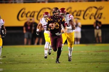 ASU QB Taylor Kelly runs for 40 yards against USC. By Brad Denny