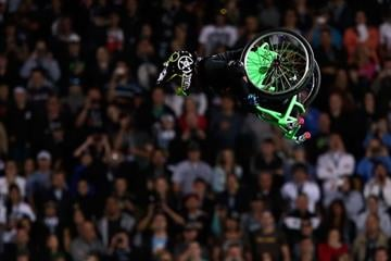 WELLINGTON, NEW ZEALAND - FEBRUARY 09:  Aaron Fotheringham performs a stunt in his wheelchair during Nitro Circus Live at Westpac Stadium on February 9, 2013 in Wellington, New Zealand.  (Photo by Hagen Hopkins/Getty Images) By Hagen Hopkins
