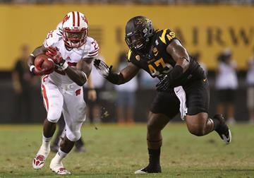 TEMPE, AZ - SEPTEMBER 14:  Davon Coleman chases down Wisconsin's Melvin Gordon (Photo by Christian Petersen/Getty Images) By Christian Petersen