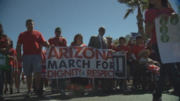 An estimated 3,000 people who want to see Congress pass a comprehensive overhaul of the nation's immigration laws marched through downtown Phoenix Saturday. By Mike Gertzman