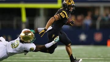 ARLINGTON, TX - OCTOBER 05:  D.J. Foster #8 of the Arizona State Sun Devils is tackled by Jaylon Smith #9 of the Notre Dame Fighting Irish at Cowboys Stadium on October 5, 2013 in Arlington, Texas.  (Photo by Ronald Martinez/Getty Images) By Mike Gertzman