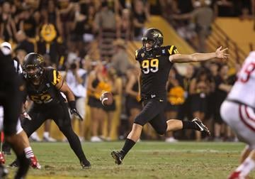 TEMPE, AZ - SEPTEMBER 14:  Punter Dom Vizzare #99 of the Arizona State Sun Devils kicks the football against the Wisconsin Badgers (Photo by Christian Petersen/Getty Images) By Christian Petersen