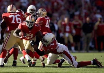 SAN FRANCISCO, CA - OCTOBER 13:  Frank Gore #21 of the San Francisco 49ers is tackled by Calais Campbell #93 of the Arizona Cardinals at Candlestick Park on October 13, 2013 in San Francisco, California.  (Photo by Ezra Shaw/Getty Images) By Ezra Shaw