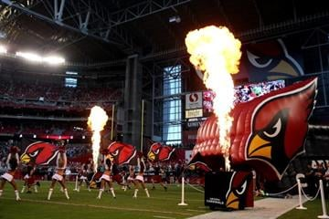 GLENDALE, AZ - OCTOBER 17: The Arizona Cardinals take the field before a game against the Seattle Seahawks at the University of Phoenix Stadium on October 17, 2013 in Glendale, Arizona.  (Photo by Christian Petersen/Getty Images) By Christian Petersen