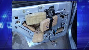 CBP officers removed packages of marijuana from within the doors of a smuggling vehicle. By Jennifer Thomas