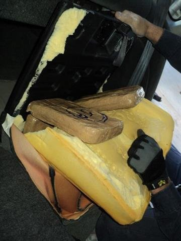 Officers removed a number of packages of marijuana from throughout the inside and outside of a smuggling vehicle. By Jennifer Thomas