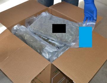 A box of packaged marijuana By Jennifer Thomas