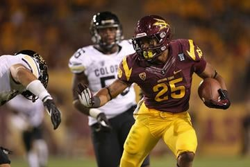 Deantre Lewis springs a big run against Colorado (Photo by Christian Petersen/Getty Images) By Christian Petersen