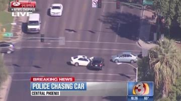 Police took two people into custody after pursuing an SUV through the streets of Phoenix Wednesday morning. By Jennifer Thomas