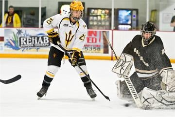 ASU's Jordan Young takes a shot against Colorado goalie Alex Palumbo last Friday night. By Brad Denny