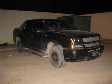 Agents found long-arm weapons, ammunition, marijuana and a stolen Border Patrol uniform in a vehicle. By Jennifer Thomas