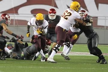 Finkenberg (62) opens a hole for running back Marion Grice By Brad Denny