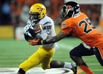 Marion Grice runs against the Beaver defense in last year's game, a 36-26 Oregon State win. (Photo by Steve Dykes/Getty Images) By Steve Dykes