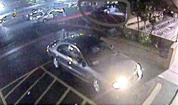 The vehicle in question can be seen at the very top of the surveillance photos in the loading/unloading zone. By Jennifer Thomas