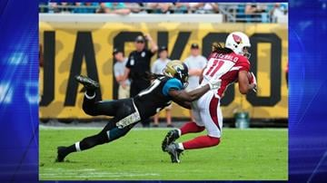 JACKSONVILLE, FL - NOVEMBER 17: Larry Fitzgerald #11 of the Arizona Cardinals runs with a catch against Johnathan Cyprien #37 of the Jacksonville Jaguars at EverBank Field on November 17, 2013 in Jacksonville, Florida. By Jennifer Thomas