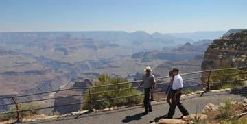 US President Barack Obama and his daughter Malia tour Hopi Point with Park Ranger Scott Kraynak at Grand Canyon National Park August 16, 2009 in Arizona. AFP PHOTO/Mandel NGAN (Photo credit should read MANDEL NGAN/AFP/Getty Images) By MANDEL NGAN