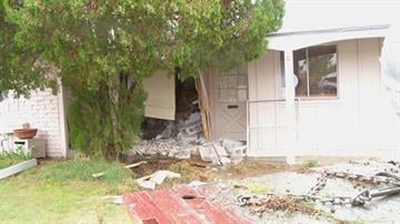 A car crashed into a house near Thomas Road and 75th Street in Scottsdale. By Jennifer Thomas