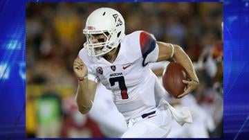 LOS ANGELES, CA - OCTOBER 10: Quarterback B.J. Denker #7 of the Arizona Wildcats runs with the ball against the USC Trojans at Los Angeles Coliseum on October 10, 2013 in Los Angeles, California. USC won 38-31. By Jennifer Thomas