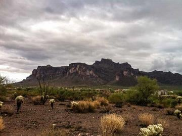 Clouds hang over the Superstition Mountains on Friday By Christina O'Haver