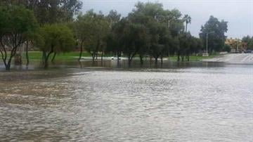 A car stuck in flooding at Continental Golf Club in Scottsdale By Christina O'Haver