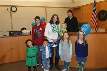 Amy Flanagan with her seven children on National Adoption Day By Christina O'Haver