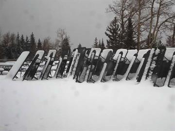 Snow blankets the deck of the ski lodge at Arizona Snowbowl By Christina O'Haver