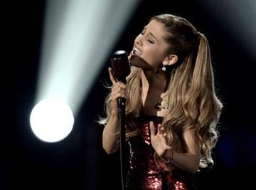 LOS ANGELES, CA - NOVEMBER 24:  Singer Ariana Grande performs onstage during the 2013 American Music Awards at Nokia Theatre L.A. Live on November 24, 2013 in Los Angeles, California.  (Photo by Kevin Winter/Getty Images) By Kevin Winter