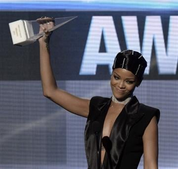 LOS ANGELES, CA - NOVEMBER 24:  Singer Rihanna accepts the AMA Icon Award onstage during the 2013 American Music Awards at Nokia Theatre L.A. Live on November 24, 2013 in Los Angeles, California.  (Photo by Kevin Winter/Getty Images) By Kevin Winter