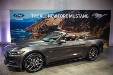 NEW YORK, NY - DECEMBER 05:  The new 2015 Ford Mustang is revealed on December 5, 2013 in New York City. The 2015 model marks the 50th anniversary of the Ford Mustang line.  (Photo by Andrew Burton/Getty Images) By Andrew Burton