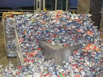 Pallets of crushed aluminum cans are referred for additional inspection after officers notice suspicious parts of the items. By Jennifer Thomas