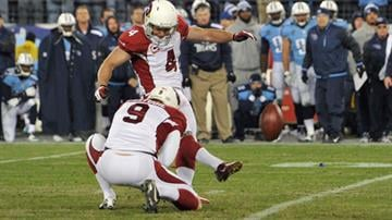 Jay Feely kicked a 41-yard field goal in overtime, and the Cardinals edged the Tennessee Titans 37-34 in overtime after blowing a 17-point lead late in the fourth quarter. By Mike Gertzman