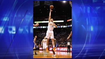 Miles Plumlee of the Phoenix Suns puts up a shot against the Golden State Warriors during the second half of the NBA game at US Airways Center on Dec. 15, 2013, in Phoenix. By Jennifer Thomas