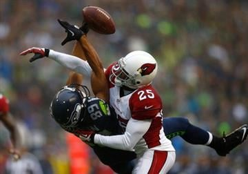 SEATTLE - DECEMBER 22:  Jerraud Powers #25 of the Arizona Cardinals breaks up a passs to Doug Baldwin #89 of the Seattle Seahawks on December 22, 2013 at CenturyLink Field in Seattle, Washington.  (Photo by Jonathan Ferrey/Getty Images) By Jonathan Ferrey
