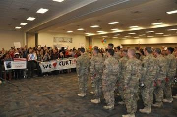 Soldiers from the 819th Engineer Company, from the Arizona Army National Guard, wait in formation to be dismissed to family and friends during a homecoming ceremony, Dec. 24. By Catherine Holland