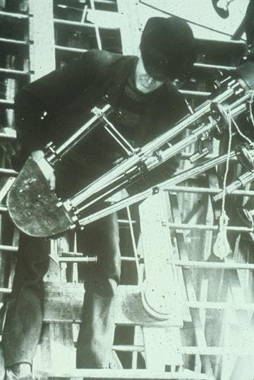 V.M. Slipher using spectrograph attached to Clark, ca. 1912.  Slipher used this equipment to detect the first evidence of the expanding nature of the universe By Mike Gertzman