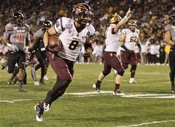 Arizona State running back D.J. Foster runs 20 yards for a touchdown against Texas Tech during the first half of the Holiday Bowl NCAA college football football game Monday, Dec. 30, 2013, in San Diego. (AP Photo/Gregory Bull) By Catherine Holland