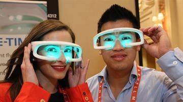 Attendees enjoy a hands-on demonstration at the Eureka Park TechZone exhibits in the Venetian at the 2013 International CES. By Catherine Holland