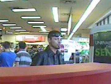 Surveillance photo of suspect By Jennifer Thomas
