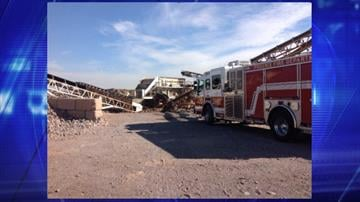 A man's arm became caught in a conveyor system at a sand, rock and gravel business near Southern and 69th avenues in Phoenix. (Photo credit: Phoenix Fire Department) By Jennifer Thomas