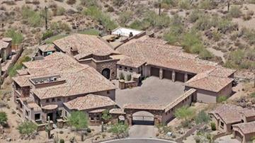 MESA, Ariz. -- This 13,000 square foot home is surrounded by mountains with incredible views. The home is listed for $3.85 million. By Mike Gertzman