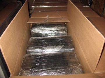 A CBP narcotics detection canine alerted to the presence of nearly 2,800 pounds of marijuana co-mingled within a shipment of wiring sets at the Nogales Commercial Facility. By Jennifer Thomas