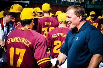 Former ASU head coach Pat Murphy and shortstop Drew Stankiewicz chat before the game By Brad Denny