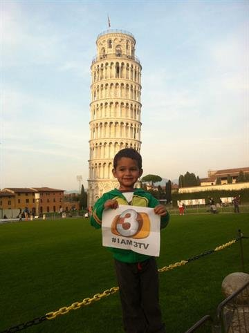 My son Isaac at the Leaning Tower of Pisa. Ciao from Italy. By Catherine Holland