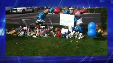 The growing memorial near the shooting scene By Jennifer Thomas
