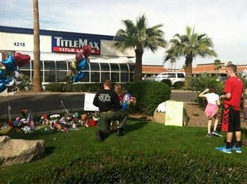 Memorial at shooting scene By Jennifer Thomas