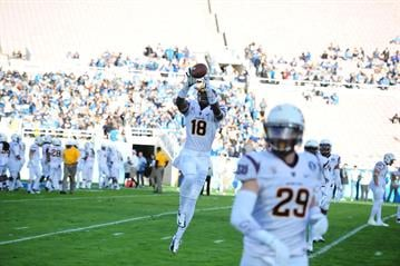 Johnson (18) warms up prior to the UCLA game. By Brad Denny