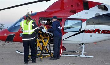 Care-Flight crew and GVFD Firefighter Daniel Burgan prepare the patient for his trip to Las Vegas. By Jennifer Thomas
